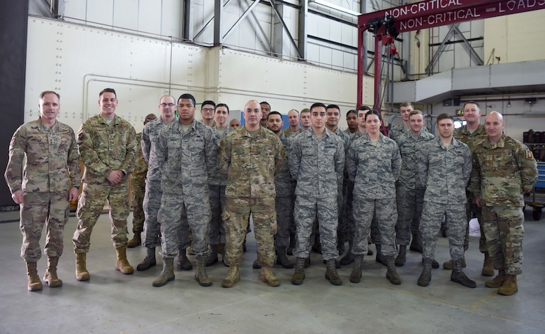 U.S. Air Force Maj. Gen. John Wood, Third Air Force commander, and U.S. Air Force Chief Master Sgt. Anthony Cruz Munoz, Third AF command chief, pose for a photo with Airmen of the 100th Maintenance Squadron aircraft ground equipment shop at RAF Mildenhall, England, April 3, 2019. Third AF leadership also toured the 100th Logistics Readiness Squadron hangar, the 100th Communications Squadron control facility and with Airmen of the 100th Security Forces Squadron. (U.S. Air Force photo by Airman 1st Class Brandon Esau)