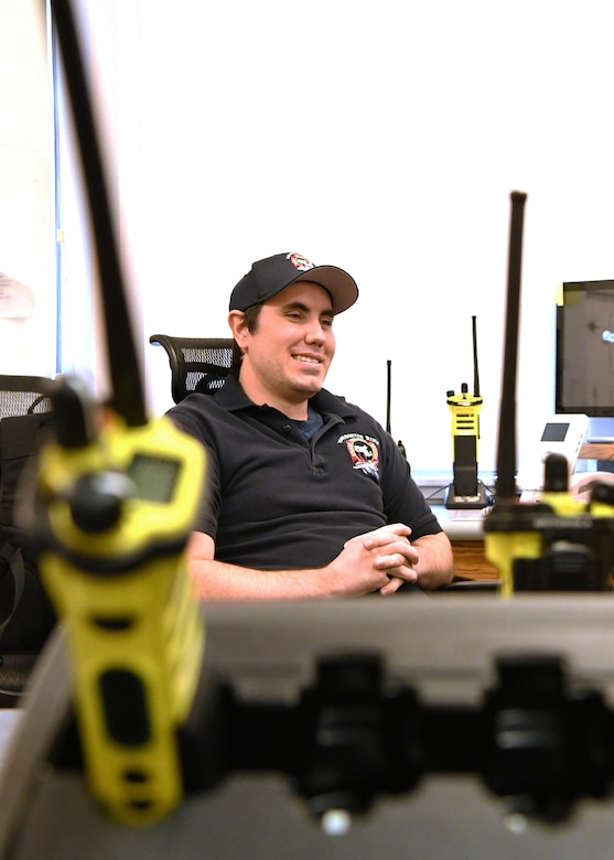 Caleb Holden, 104th Fighter Wing firefighter, prepares to answer 911 calls in the Fire Department alarm room April 18, 2019, at Barnes Air National Guard Base, Massachusetts. The firefighter on shift in the alarm room is reponsible for answering emergency calls and ensuring the proper aid is sent to assist.