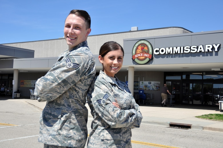 Senior Airmen Kassandra Minigh and Collin Millar, 14th Intelligence Squadron all-source analysts, provided aid to a customer having a seizure at the Wright-Patterson Air Force Base commissary March 27, 2019. Their efforts helped save the woman's life.