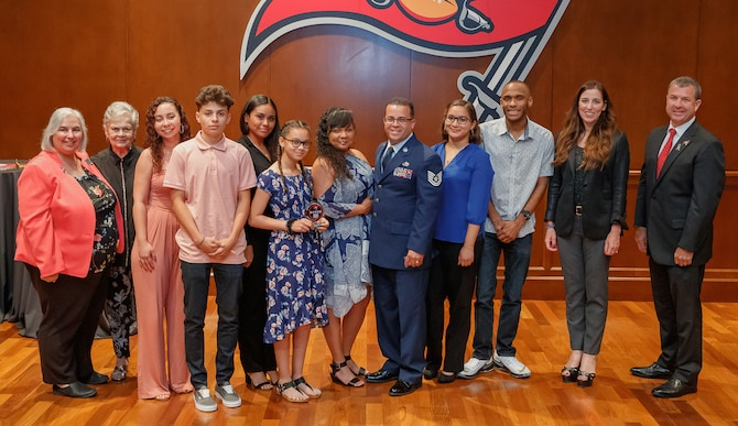 During a ceremony held 17 April, at the Tampa Bay Buccaneers Headquarters, Tampa, Florida, the family of Tech. Sgt. Edgar Serrano, 927th Aircraft Structural Maintenance craftsman, received the 2019 General Norman Schwarzkopf Military Family of the year in the Guard and Reserve category. (U.S. Air Force Photo/Courtesy)