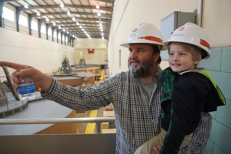 Kurt Ashley, engineer at the Nashville District, shows his son Thomas Ashley how the hydropower plant operates April 19, 2019 at the Old Hickory Dam Power Plant in Hendersonville, Tenn. (USACE photo by Mark Rankin)