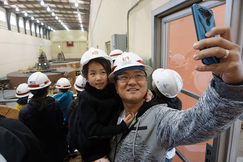 Joon Lee, geologist for the U.S. Army Corps of Engineers Nashville District, takes a selfie picture of his daughter Olivia during a tour of the Old Hickory Dam Power Plant April 19, 2019. (USACE photo by Mark Rankin)