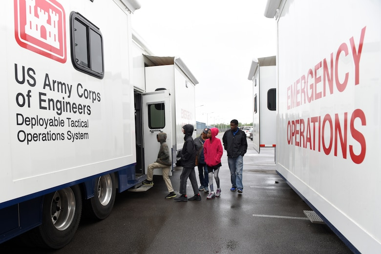 Participants of the U.S. Army Corps of Engineers Nashville District Bring Your Family to Work Day get onboard a Deployable Tactical Operations System at Old Hickory Dam on the Cumberland River in Old Hickory, Tenn., April 19, 2019. They learned about how the Corps of Engineers supports natural disasters and other important national emergency management missions. (USACE photo by Lee Roberts)