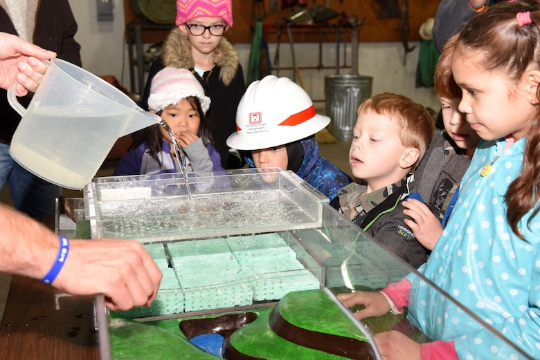 Kids participate in a practical exercise to learn about how development affects waterways and wetlands during the U.S. Army Corps of Engineers Nashville District Bring Your Family to Work Day April 19, 2019 at Old Hickory Dam on the Cumberland River in Old Hickory, Tenn.  (USACE photo by Lee Roberts)