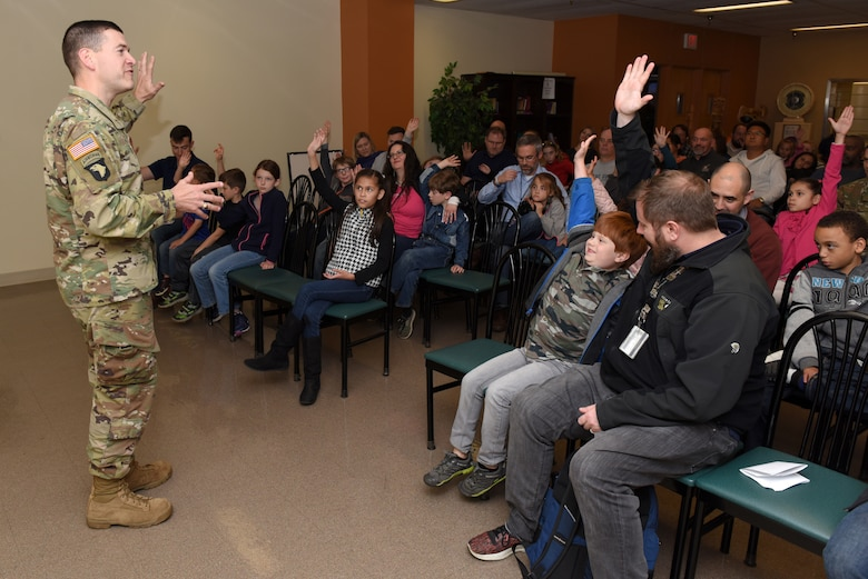 Lt. Col. Cullen Jones, U.S. Army Corps of Engineers Nashville District commander, welcomes employees and their family members to the Nashville District Headquarters at the Estes Kefauver Federal Building in Nashville, Tenn., during Bring Your Family to Work Day April 19, 2019. (USACE photo by Lee Roberts)