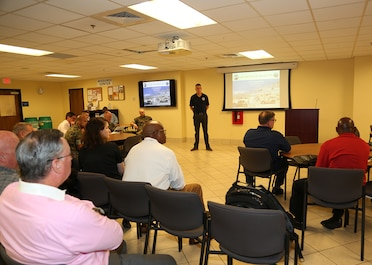 Andrew Rodgers, program manager, Light Tactical Vehicles, discusses the latest developments of the Joint Light Tactical Vehicle Program with attendees during a briefing held in the Marine Corps Logistics Command Multipurpose Room, April 9.