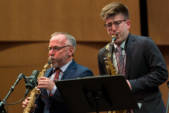 Internationally acclaimed saxophonist Joe Lulloff plays alongside his son, Jordan Lulloff, as they perform with the U.S. Air Force Concert Band on Thursday, Apr. 18, at the Rachel M. Schlesinger Concert Hall and Arts Center in Alexandria, Virginia. This concert was the final installment of The U.S. Air Force Band's 2019 Guest Artist Series. (U.S. Air Force photo by Master Sgt. Grant Langford)