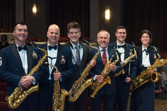 Internationally acclaimed saxophonist Joe Lulloff and his son, Jordan Lulloff, pose with the saxophone section of the U.S. Air Force Concert Band on Thursday, Apr. 18, at the Rachel M. Schlesinger Concert Hall and Arts Center in Alexandria, Virginia. Joe Lulloff and Jordan Lulloff performed on the final installment of The U.S. Air Force Band's 2019 Guest Artist Series. (U.S. Air Force photo by Master Sgt. Grant Langford)