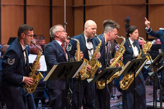Internationally acclaimed saxophonist Joe Lulloff and his son, Jordan Lulloff, join the saxophone section of the U.S. Air Force Concert Band on Thursday, Apr. 18, at the Rachel M. Schlesinger Concert Hall and Arts Center in Alexandria, Virginia. This concert was the final installment of The U.S. Air Force Band's 2019 Guest Artist Series. (U.S. Air Force photo by Master Sgt. Grant Langford)