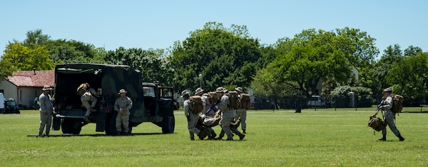 Navy Corpsmen perform a search and rescue demonstration April 20, 2019, at Joint Base San Antonio-Fort Sam Houston, Texas during the Fiesta and Fireworks Extravaganza. Fiesta honors the long-standing partnership between the U.S. military and San Antonio in annual Fiesta events, which commemorate Texas' independence after the Battle of San Jacinto and the Alamo.  (U.S. Air Force photo by Senior Airman Stormy Archer)