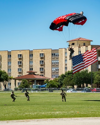 Members of the U.S. Army Black Daggers Parachute Demonstration Team parachute into MacArthur Parade Field April 20, 2019, at Joint Base San Antonio-Fort Sam Houston, Texas during the Fiesta and Fireworks Extravaganza. Fiesta honors the long-standing partnership between the U.S. military and San Antonio in annual Fiesta events, which commemorate TExas' independence after the Battle of San Jacinto and the Alamo.  (U.S. Air Force photo by Senior Airman Stormy Archer)