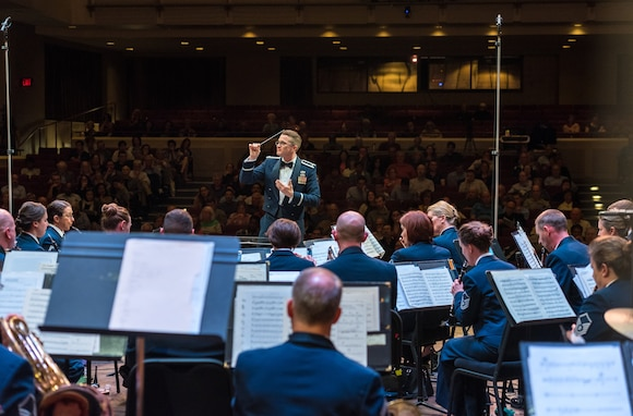 First Lieutenant Phillip Emory conducts the Concert Band on Apr. 18, during the final concert of The U.S. Air Force Band's 2019 Guest Artist Series. The concert featured internationally acclaimed saxophonist Joe Lulloff. (U.S. Air Force photo by Master Sgt. Grant Langford)
