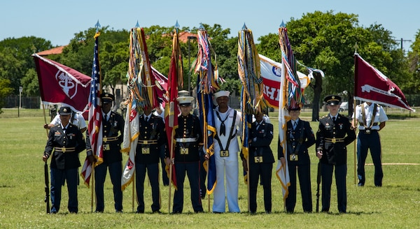 A joint service color guard presents the colors April 20, 2019, at Joint Base San Antonio-Fort Sam Houston, Texas during the Fiesta and Fireworks Extravaganza. Fiesta honors the long-standing partnership between the U.S. military and San Antonio in annual Fiesta events, which commemorate TExas' independence after the Battle of San Jacinto and the Alamo.  (U.S. Air Force photo by Senior Airman Stormy Archer)