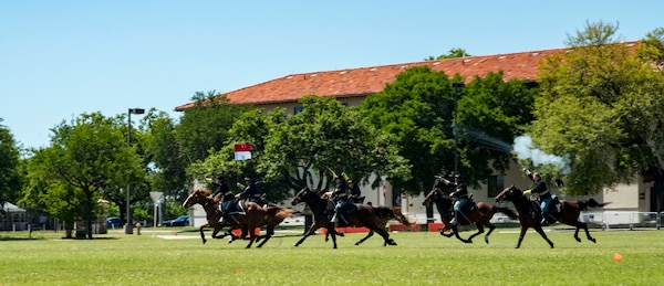 Soldiers demonstrate a cavalry charge April 20, 2019, at Joint Base San Antonio-Fort Sam Houston, Texas during the Fiesta and Fireworks Extravaganza. Fiesta honors the long-standing partnership between the U.S. military and San Antonio in annual Fiesta events, which commemorate Texas' independence after the Battle of San Jacinto and the Alamo.  (U.S. Air Force photo by Senior Airman Stormy Archer)
