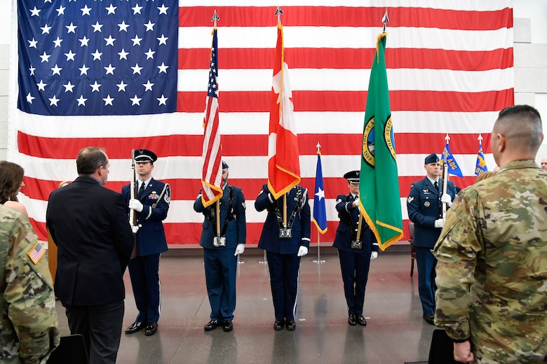 Members of the Western Air Defense Sector Honor Guard post the colors during the 225th Air Defense Group assumption of command ceremony at the Pierce County Readiness Center, Camp Murray, Washington, April 10, 2019. (U.S. Air National Guard photo by Capt. Colette Muller)