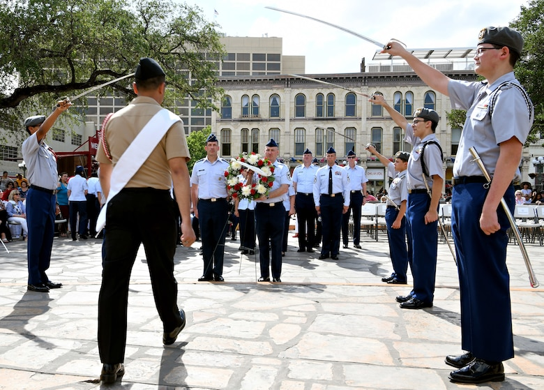 "Maj. Gen. Robert Skinner, 24th Air Force commander, and Chief Master Sgt. David Klink, 24th AF command chief, present the 24th Air Force wreath during the Fiesta San Antonio ""Pilgrimage to the Alamo"" on April 22, 2019. Fiesta San Antonio is held annually to honor those who lost their lives at the Alamo and Battle of San Jacinto. (U.S. Air Force photo by Tech. Sgt. R.J. Biermann)"