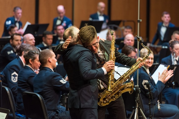 Internationally acclaimed saxophonist Joe Lulloff embraces his son, Jordan Lulloff, after they perform with the U.S. Air Force Concert Band on Thursday, Apr. 18, at the Rachel M. Schlesinger Concert Hall and Arts Center in Alexandria, Virginia. This concert was the final installment of The U.S. Air Force Band's 2019 Guest Artist Series. (U.S. Air Force photo by Master Sgt. Grant Langford)