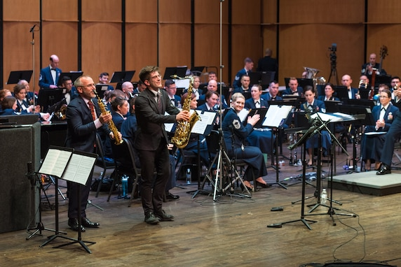 Internationally acclaimed saxophonist Joe Lulloff bows alongside his son, Jordan Lulloff, after they perform with the U.S. Air Force Concert Band on Thursday, Apr. 18, at the Rachel M. Schlesinger Concert Hall and Arts Center in Alexandria, Virginia. This concert was the final installment of The U.S. Air Force Band's 2019 Guest Artist Series. (U.S. Air Force photo by Master Sgt. Grant Langford)