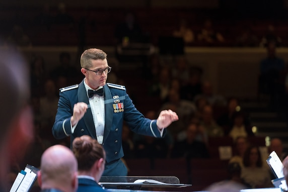 First Lieutenant Phillip Emory conducts the Concert Band on Apr. 18, during the final concert of The U.S. Air Force Band's 2019 Guest Artist Series. The concert featured internationally acclaimed saxophonist Joe Lulloff.