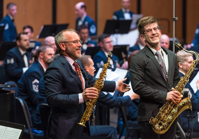 Internationally acclaimed saxophonist Joe Lulloff stands alongside his son, Jordan Lulloff, after their performance with the U.S. Air Force Concert Band on Thursday, Apr. 18, at the Rachel M. Schlesinger Concert Hall and Arts Center in Alexandria, Virginia. This concert was the final installment of The U.S. Air Force Band's 2019 Guest Artist Series. (U.S. Air Force photo by Master Sgt. Grant Langford)