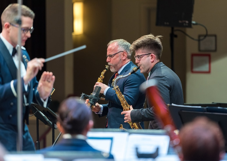 Internationally acclaimed saxophonist Joe Lulloff plays alongside his son, Jordan Lulloff, as they perform with the U.S. Air Force Concert Band on Thursday, Apr. 18 at the Rachel M. Schlesinger Concert Hall and Arts Center in Alexandria, Virginia. This concert was the final installment of The U.S. Air Force Band's 2019 Guest Artist Series. (U.S. Air Force photo by Master Sgt. Grant Langford)