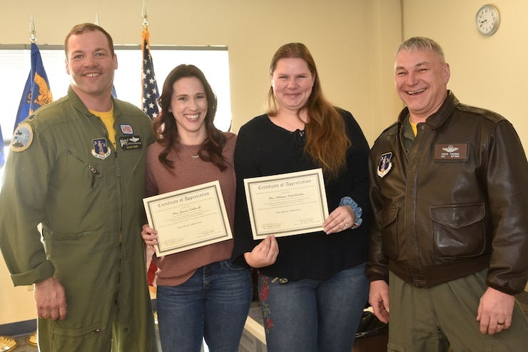 Lt. Col. Jason Green, far left, Commander, 186th Airlift Squadron and Col. Trace Thomas, far right, Commander, 120th Operations Group, presented Jessica Caldwell, left, and Melissa Nikolakakos, with certificates of appreciation for their support as Key Spouses for the 120th OG. During the March drill senior leaders from the 120th Airlift Wing, Montana Air National Guard, recognized all of the wing's Key Spouses for their support.