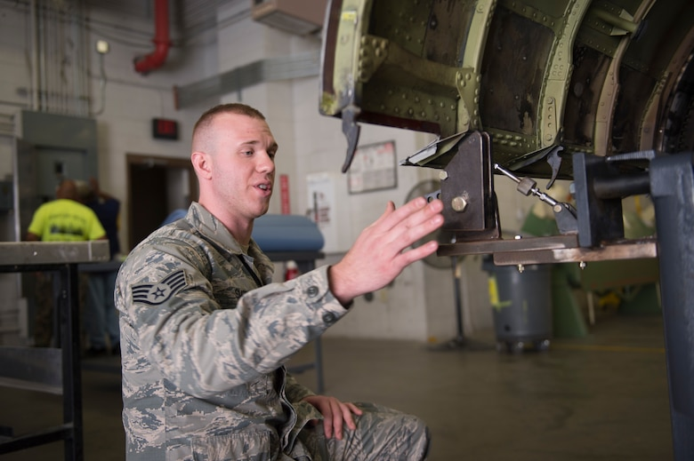 U.S. Air Force Staff Sgt. Quinn Smith, a sheet metal technician with the 116th Air Control Wing aircraft structural maintenance section, Georgia Air National Guard, explains the capabilities of the newly-created cowling fixture table April 3, 2019, at Robins AFB, Ga.