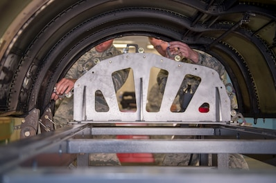 U.S. Air Force Airman 1st Class Joseph Pierce and Staff Sgt. Quinn Smith, sheet metal technicians with the 116th Air Control Wing aircraft structural maintenance section, Georgia Air National Guard, secure a Joint STARS cowling the newly-created cowling fixture table April 3, 2019, at Robins AFB, Ga.