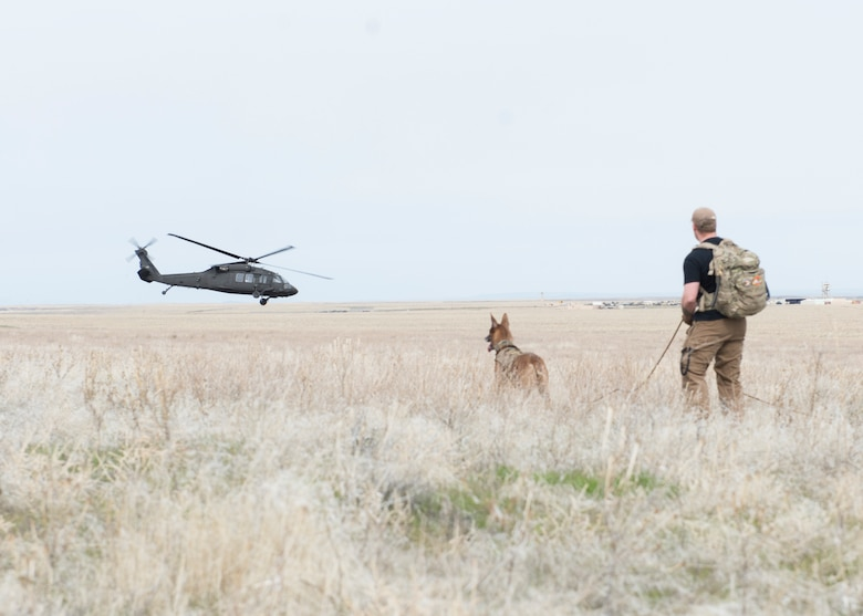 A helicopter retrieves aircrew from sailor creek range for Combat Survival Training during Gunfighter Flag, March 2, 2019. Aircrew from Mountain Home Air Force base underwent refresher training on evading capture and acquiring recovery from Combat Search and Rescue Personnel during Gunfighter Flag as the 366th Security Forces used their K9s to search for them. (U.S. Air Force photo by Senior Airman Tyrell Hall)