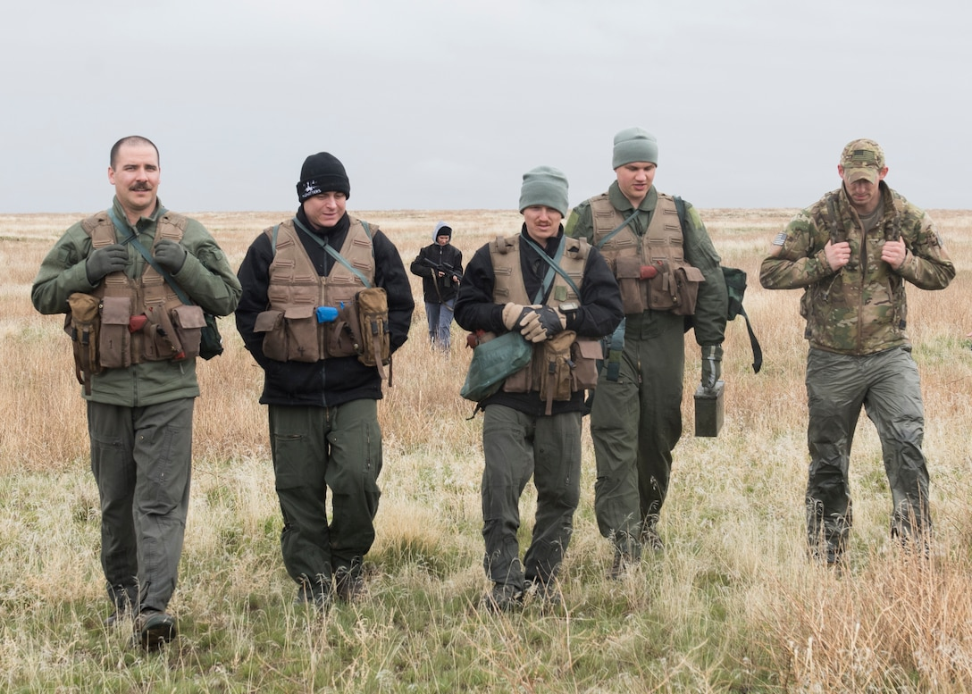 Staff Sergeant David H Chorpenning, 366th OSKP, walks with a team he organized for a combat survival training after an exercise for Gunfighter Flag, March 2, 2019. Air crew from Mountain Home Air Force base underwent refresher training on evading capture and acquiring recovery from Combat Search and Rescue Personnel during Gunfighter Flag. (U.S. Air Force photo by Senior Airman Tyrell Hall)