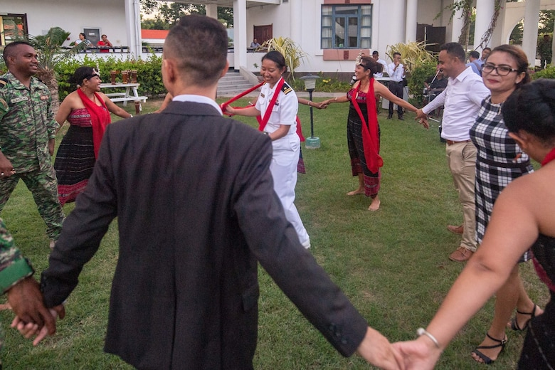 DILI, Timor-Leste (April 23, 2019) – U.S. Navy Lt. j.g. Allison Adamos dances with locals and Timor-Leste Defense Force members during the Pacific Partnership 2019 opening ceremony reception for Timor-Leste. Pacific Partnership, now in its 14th iteration, is the largest annual multinational humanitarian assistance and disaster relief preparedness mission conducted in the Indo-Pacific. Each year the mission team works collectively with host and partner nations to enhance regional interoperability and disaster response capabilities, increase security and stability in the region, and foster new and enduring friendships in the Indo-Pacific.