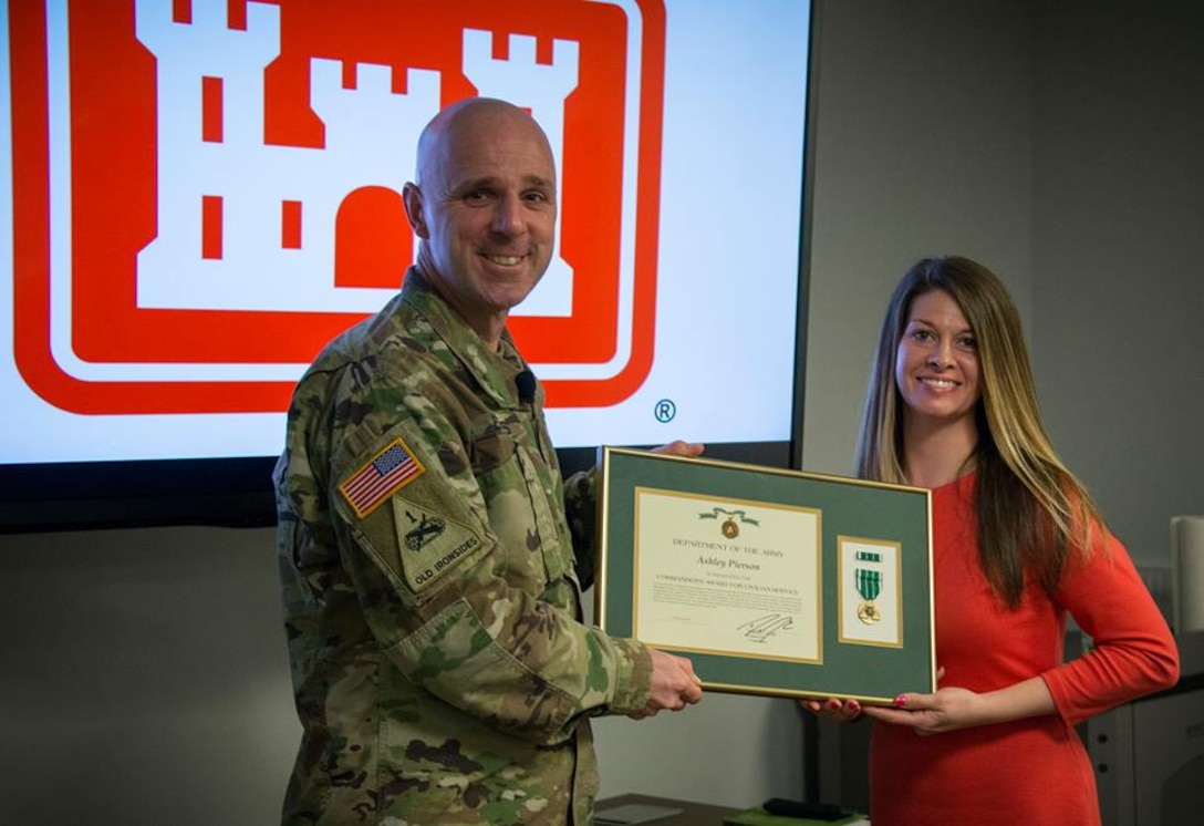 COL Evers presents Ashley Pierson with the Commanders Award