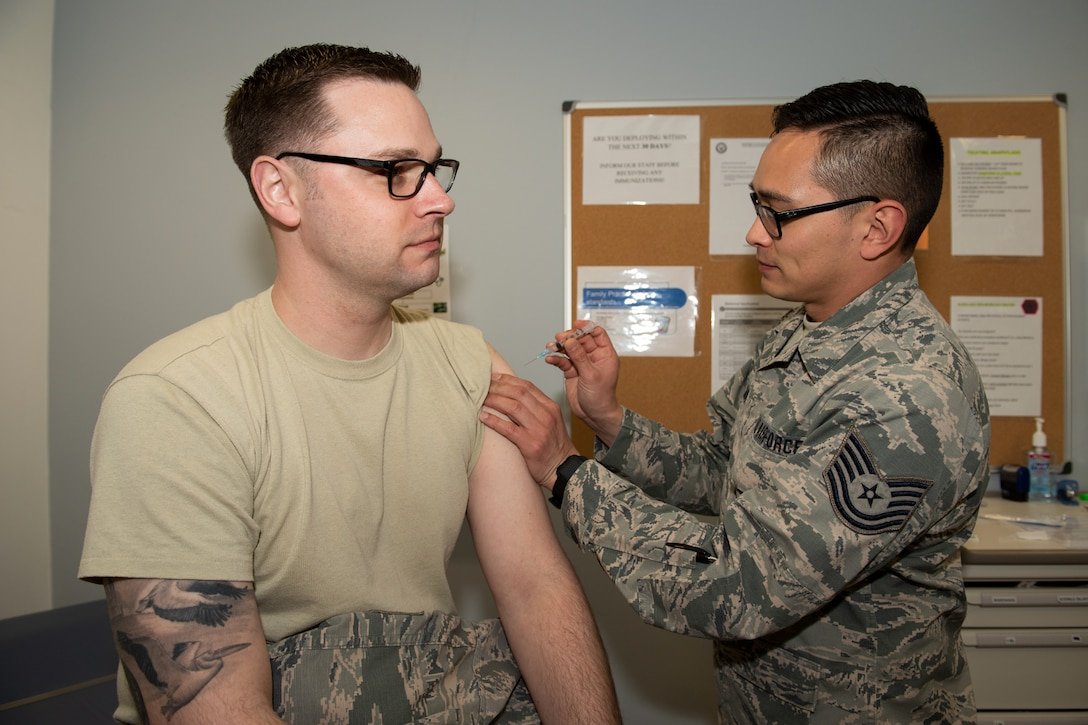 U.S Air Force Tech. Sgt. Ben Axman, 184th Medical Group aerospace medical technician, assigned to McConnell Air Force Base, Kan., practices medical procedures with Tech. Sgt. Robert Bell, 184th Medical Group medical technician, at RAF Alconbury, England, April 16, 2019. The 184th MDG worked closely with medical units at RAF Alconbury, RAF Croughton and RAF Lakenheath to improve total force medical capabilities. (U.S. Air Force photo by Airman 1st Class Jennifer Zima)