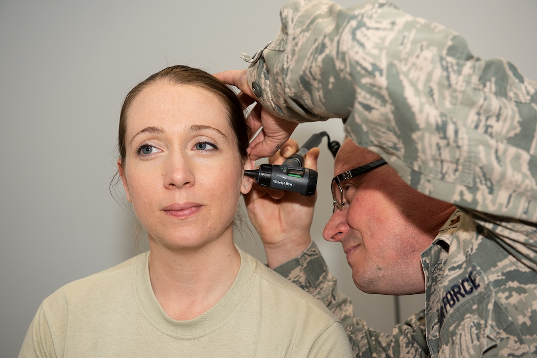 U.S Air Force Maj. Richard Nold, 184th Medical Group clinical nurse, assigned to McConnell Air Force Base, Kan., practices medical procedures with Capt. Jennifer Andrews, 423rd Medical Squadron clinical nurse, at RAF Alconbury, England, April 16, 2019. The 184th MDG worked closely with medical units at RAF Alconbury, RAF Croughton and RAF Lakenheath to improve total force medical capabilities. (U.S. Air Force photo by Airman 1st Class Jennifer Zima)