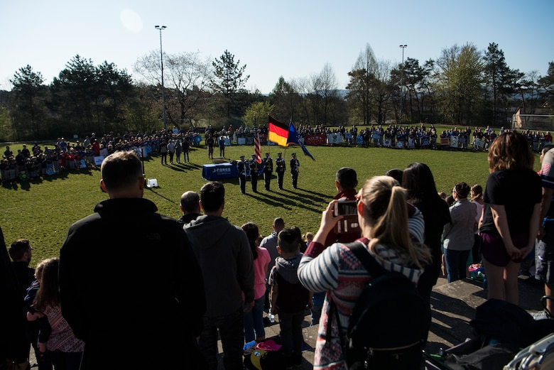 Brig. Gen. Mark R. August, 86th Airlift Wing commander gave opening remarks during the 2019 Spring Youth Sports kickoff opening day event on Ramstein Air Base, Germany, April 20, 2019.