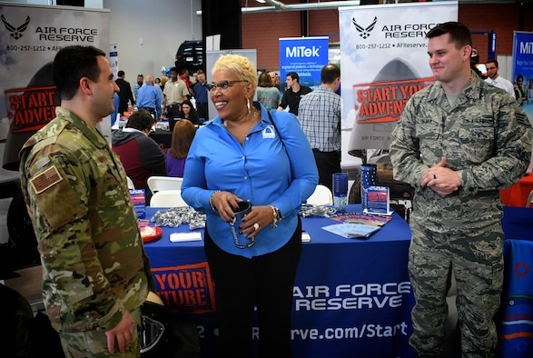 Teamwork in action:  From left, 932nd Airlift Wing explosive ordnance disposal technician, Staff Sgt. Randall Brown, and 932nd Recruiting Service Staff Sgt. Justin Palmer help run a community relations booth April 18, 2019, in Saint Louis, Missouri.  They answered questions about reserve duties and shared stories of their individual backgrounds, while also telling the overall Citizen Airman story at Ranken Technical College career fair. For more information on jobs in the Air Force Reserve, those interested should call 1-800-257-1212. (U.S. Air Force photo by Lt. Col. Stan Paregien)