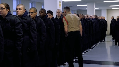 Recruits in line, listening to Recruit Division Commander shouting