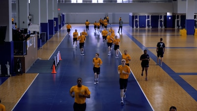 Recruits jogging in the gym