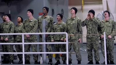 Recruits shouting, motivating their fellow sailor