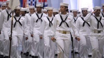 Recruits marching with their white uniforms