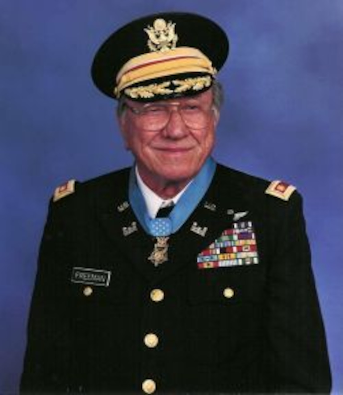 An official photo of a soldier in formal dress wearing a Medal of Honor.