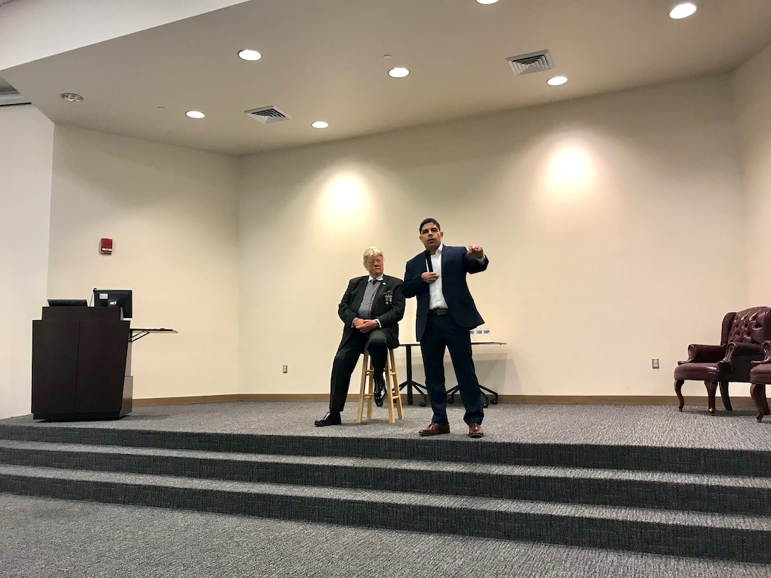 Dave Roever, U.S. Navy veteran and wounded warrior (seated) and U.S. Army Capt. (Ret.) John Arroyo, speak to Keesler Airmen about their personal experiences of recovery during a resiliency talk April 11, 2019 at Keesler Air Force Base, Miss. Both Roever and Arroyo shared how they continue to fight through their physical and emotional pain to teach others about resiliency. (U.S. Air Force photo by Sarah Loicano)
