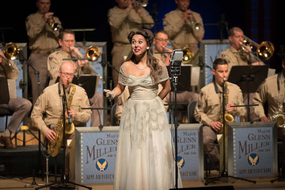 "Acclaimed jazz vocalist Veronica Swift sings during ""On the Air: A Glenn Miller Swing Celebration,"" a show featuring The U.S. Air Force Band performing the music of big band legend Major Glenn Miller on April 2, 2019, at the Music Center at Strathmore in North Bethesda, Maryland. The U.S. Air Force Band partnered with Washington Performing Arts to present this concert highlighting the legacy of Major Miller's music and his leadership of the Army Air Force Band. This year marks the 75th anniversary of the disappearance of Miller's plane during World War II. (U.S. Air Force Photo by Technical Sgt. Valentine Lukashuk)"