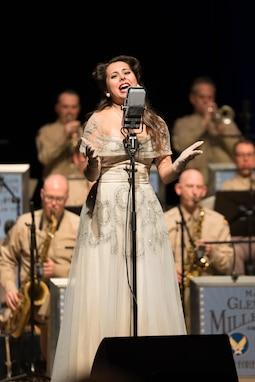 """Acclaimed jazz vocalist Veronica Swift sings during """"On the Air: A Glenn Miller Swing Celebration,"""" a show featuring The U.S. Air Force Band performing the music of big band legend Major Glenn Miller on April 2, 2019, at the Music Center at Strathmore in North Bethesda, Maryland. The U.S. Air Force Band partnered with Washington Performing Arts to present this concert highlighting the legacy of Major Miller's music and his leadership of the Army Air Force Band. This year marks the 75th anniversary of the disappearance of Miller's plane during World War II. (U.S. Air Force Photo by Technical Sgt. Valentine Lukashuk)"""