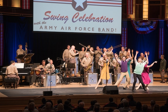 """Professional dancers take center stage during """"On the Air: A Glenn Miller Swing Celebration,"""" a show featuring The U.S. Air Force Band performing the music of big band legend Major Glenn Miller on April 2, 2019, at the Music Center at Strathmore in North Bethesda, Maryland. The U.S. Air Force Band partnered with Washington Performing Arts to present this concert highlighting the legacy of Major Miller's music and his leadership of the Army Air Force Band. This year marks the 75th anniversary of the disappearance of Miller's plane during World War II. (U.S. Air Force Photo by Technical Sgt. Valentine Lukashuk)"""