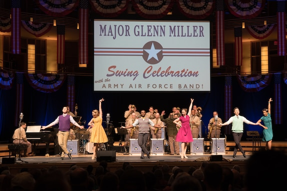"Members of The U.S. Air Force Band perform as dancers take center stage during ""On the Air: A Glenn Miller Swing Celebration,"" a show featuring the music of big band legend Major Glenn Miller on April 2, 2019, at the Music Center at Strathmore in North Bethesda, Maryland. The U.S. Air Force Band partnered with Washington Performing Arts to present this concert highlighting the legacy of Major Miller's music and his leadership of the Army Air Force Band. This year marks the 75th anniversary of the disappearance of Miller's plane during World War II. (U.S. Air Force Photo by Technical Sgt. Valentine Lukashuk)"