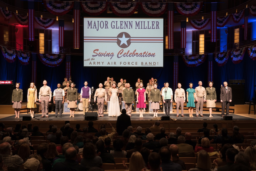 """The entire cast comes onstage for the finale of """"On the Air: A Glenn Miller Swing Celebration,"""" a show featuring The U.S. Air Force Band performing the music of big band legend Major Glenn Miller on April 2, 2019, at the Music Center at Strathmore in North Bethesda, Maryland. The U.S. Air Force Band partnered with Washington Performing Arts to present this concert highlighting the legacy of Major Miller's music and his leadership of the Army Air Force Band. This year marks the 75th anniversary of the disappearance of Miller's plane during World War II. (U.S. Air Force Photo by Technical Sgt. Valentine Lukashuk)"""