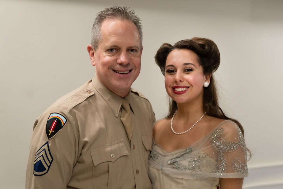 "Chief Master Sgt. Kevin Burns poses with acclaimed jazz vocalist Veronica Swift at the conclusion of ""On the Air: A Glenn Miller Swing Celebration,"" a show that featured The U.S. Air Force Band performing the music of big band legend Major Glenn Miller on April 2, 2019, at the Music Center at Strathmore in North Bethesda, Maryland. The U.S. Air Force Band partnered with Washington Performing Arts to present this concert highlighting the legacy of Major Miller's music and his leadership of the Army Air Force Band. This year marks the 75th anniversary of the disappearance of Miller's plane during World War II. (U.S. Air Force Photo by Master Sgt. Josh Kowalsky)"