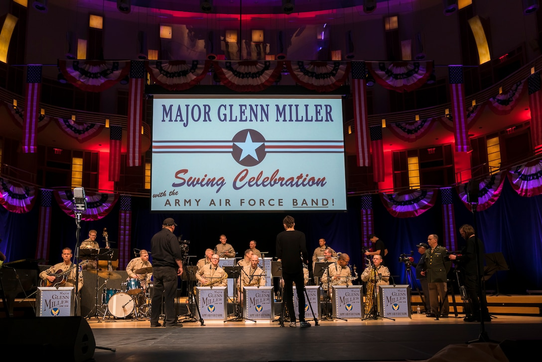 "The camera crew comes in for close-ups during ""On the Air: A Glenn Miller Swing Celebration,"" a show that featured The U.S. Air Force Band performing the music of big band legend Major Glenn Miller on April 2, 2019, at the Music Center at Strathmore in North Bethesda, Maryland. The U.S. Air Force Band partnered with Washington Performing Arts to present this concert highlighting the legacy of Major Miller's music and his leadership of the Army Air Force Band. This year marks the 75th anniversary of the disappearance of Miller's plane during World War II. (U.S. Air Force Photo by Master Sgt. Josh Kowalsky)"
