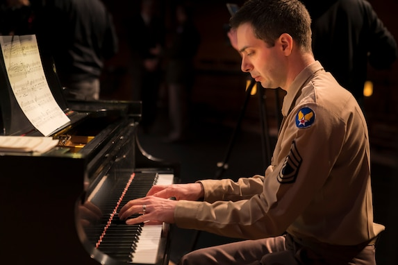 "Technical Sgt. Chris Ziemba plays the piano at ""On the Air: A Glenn Miller Swing Celebration,"" a show that featured The U.S. Air Force Band performing the music of big band legend Major Glenn Miller on April 2, 2019, at the Music Center at Strathmore in North Bethesda, Maryland. The U.S. Air Force Band partnered with Washington Performing Arts to present this concert highlighting the legacy of Major Miller's music and his leadership of the Army Air Force Band. This year marks the 75th anniversary of the disappearance of Miller's plane during World War II. (U.S. Air Force Photo by Master Sgt. Josh Kowalsky)"
